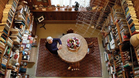 Marilyn Hoffner Greenberg in her library