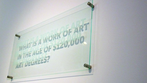 "BFAMFAPhD Statements (2013) plexiglass, plaque hardware 11"" x 23"" x 1"". Photo by Caroline Woolard."