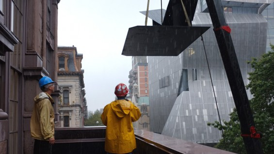 """The Glider"" being installed on to the Cooper Union Foundation Building"