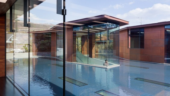 Steven Holl Architects--Daeyang Gallery and House, 2012, three pavilions separated by a sheet of water | photo: Iwan Baan