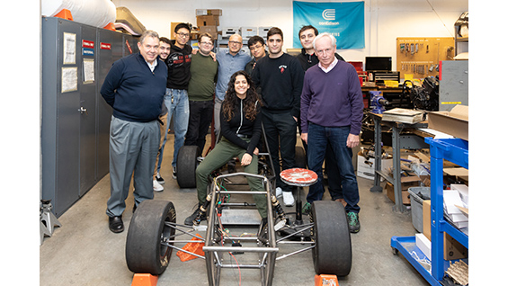 Members of the Formula SAE team and interim CTO Robert Reinckens (far left) met renowned  race car driver Simon Kirkby (far right).