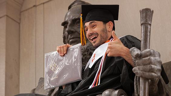 A 2016 graduate enjoys commencement day