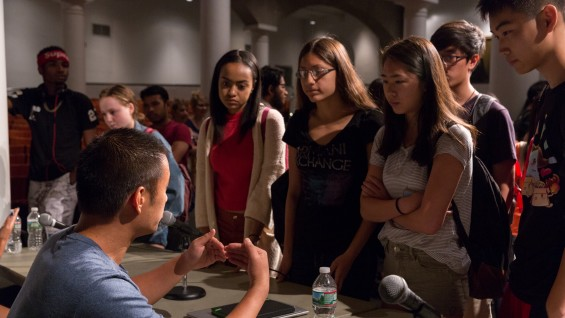 Students talking to Jonathan Chin, co-founder of ShareMeals, after the panel discussion. Photo: João Enxuto
