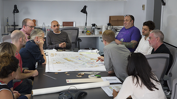 Members of the proposal team discussing next steps for the lab. Photo by Lea Bertucci