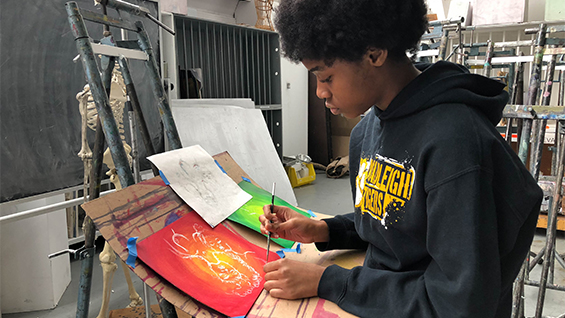 Student in Painting Class