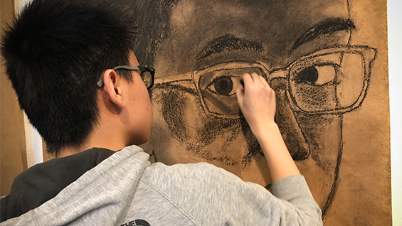 Student in Drawing Class