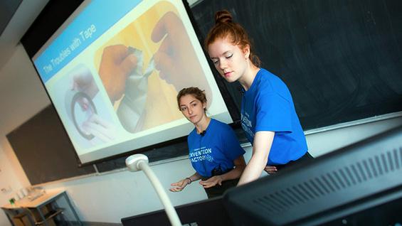 Jessica Marshall and Deanna Kovalcin demo their universal tape dispenser