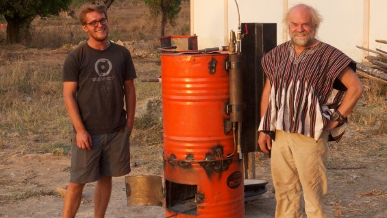 Julien Caubel (ME'2011) and Prof. Toby Cumberbatch next to a prototype steam engine built from scrap metal