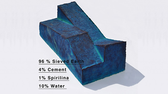 One of Max's pressed earthen bricks. Spirulina is an algae that gives the brick is cerulean hue
