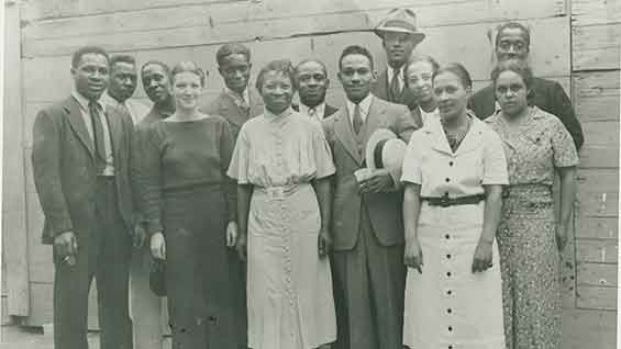Harlem Community Art Center of the Works Progress Administration   Front row (left to right): Zell Ingram, Pemberton West, Augusta Savage, Robert Pious, Sarah West and Gwendolyn Bennett; back row (left to right): Elton Fax, Rex Goreleigh, Fred Perry, William Artis, Francisco Lord, Louise Jefferson and Norman Lewis. Photographer: Andrew Herman. Image credit: Schomburg Center for Research in Black Culture, Photographs and Prints Division, The New York Public Library.