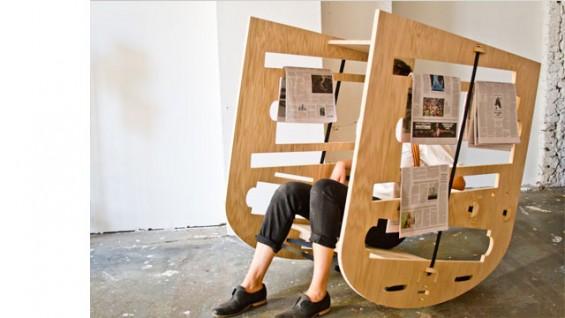 """Queer Rocker (2013), CNC prototype oak plywood, rachet straps, newspapers, 48"""" x 30"""" x 44"""""""