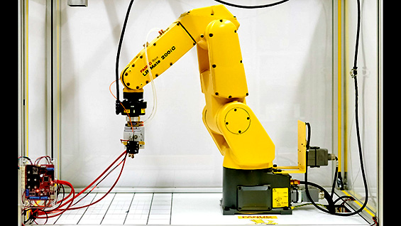 A robotic arm adapted as a 3D printer to use a carbon fiber reinforced polymer filament. Photo courtesy of Jackie Song