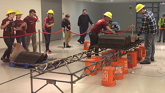 The Cooper Union team watches their work at the National Student Steel Bridge Competition<br><br>