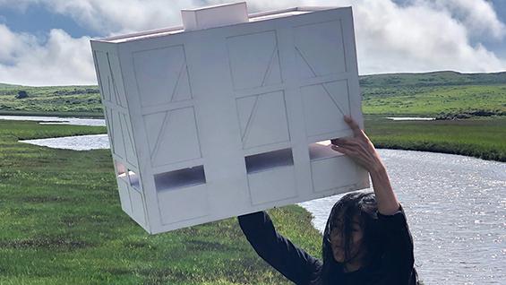 Brenda Zhang (Bz) holding up a model.