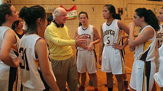 Dean Baker speaks with the women's basketball team