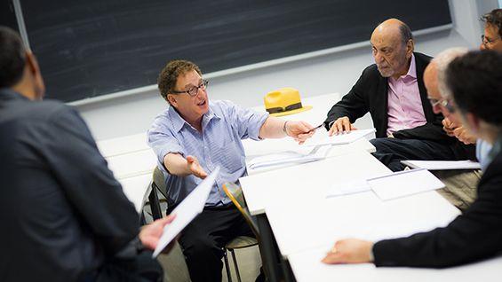 The judges, including Ron Slusky (l) and Milton Glaser (r), deliberate