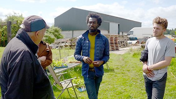 Allan Huson on his vegetable farm in Hawarden, North Wales, with DeVonn Francis and Angus Buchanan-Smith