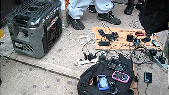 The days after: phones charging at a gas generator downtown (photo courtesy Gearoid Dolan)