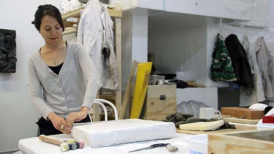 Emilie Gossiaux working in Daniel Arsham's studio in 2013