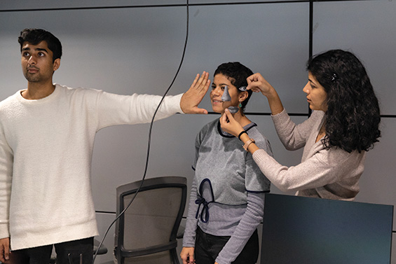 Students using masks to test facial recognition software.
