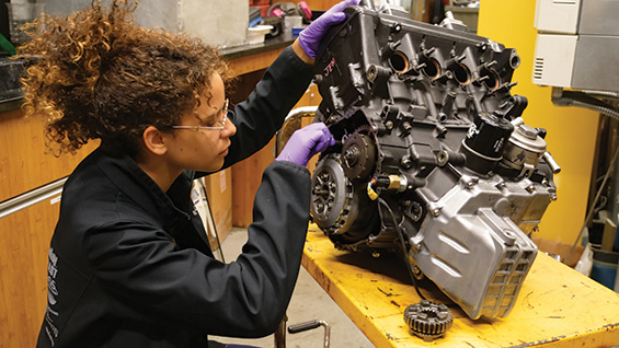 Image: Student with internal combustion engine.