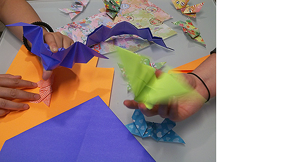 "Uyen ""Win Win"" Nguyen and Jennifer Tashman demonstrate their origami bats"