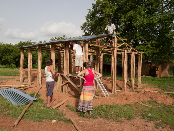 Julien Caubel (ME) and Leila Rzyska (Arch) constructing a house out of mud and bamboo with Tetteh, a local builder. Funded by NSF, Thornton-Tomasetti Foundation