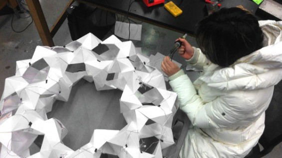 "Uyen (""Win"") Nguyen working with her team in the engineering labs"
