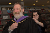 Ashley Armitage helped Professor David Gersten before the ceremony.