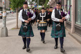 The East Village was alerted to the start of Cooper's graduation with the music of a bagpipe corps, a school tradition.