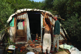 Danielle and Ofek pictured building the ecological tiny house, Amirim