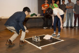The final rounds of Robot Sumo, student designed robots compete for victory