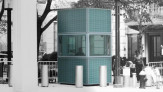Rendering of bullet proof security kiosk with 'urban camouflage' patterned glass cladding.