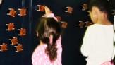 "Children rearranging synchronized infrared ""fireflies"""