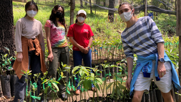 Image left to right: Seena Seon ChE'23, Joya Debi EE'23, Anna (employee at the Barbara Ford Peacebuilding Center in charge of the farm) and Brandon Bunt BSE'22.