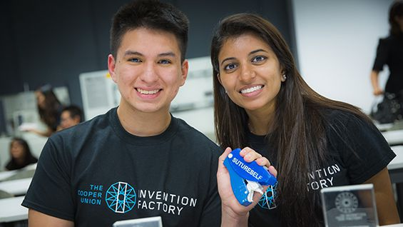 Giovanni Sanchez and Ruchi Patel show off their winning invention, SutureSelf