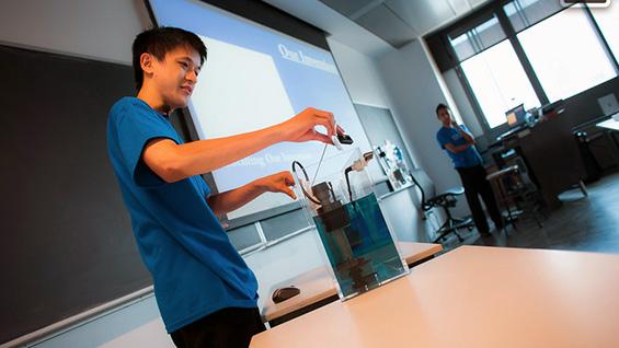 Eric Nguyen demonstrates his team's dual-flush toilet adaptor
