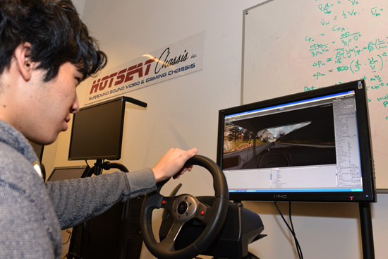 Eric Leong (ME'14) in the Hotseat Chasis simulation system
