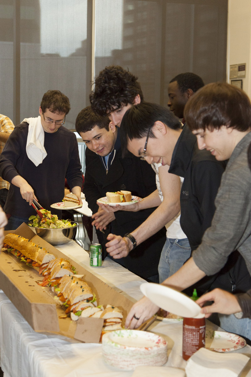 Students celebrate the end of Student Engagement and Philanthropy Week with sandwiches and cake